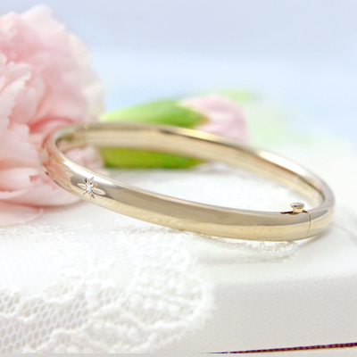 Gorgeous diamond bangle bracelet for children in 14kt gold filled. Safety hinged closure, Lifetime Warranty.
