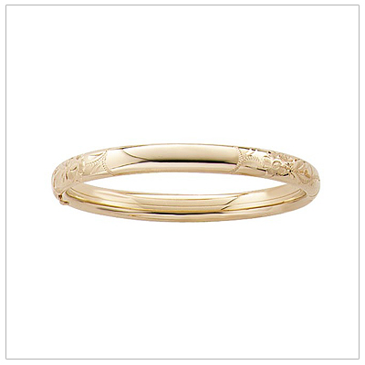 14kt gold filled bangle bracelet for girls with an engraved floral pattern. These bangle bracelets are sized for children and have safety clasp.