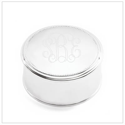 Round silver plated jewelry box with beaded trim. Engrave the lid of the box, engraving included. Engraved gifts.