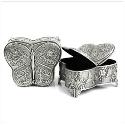 Butterfly jewelry box with antique pewter tone and two opening wings.