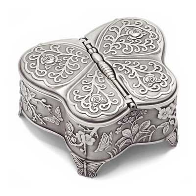 Butterfly jewelry box for girls with two wings that open, hinged lid, velveteen lined interior.