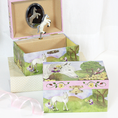 Adorable musical jewelry box for children with horse and fairy design. Pop-up, twirling horse.