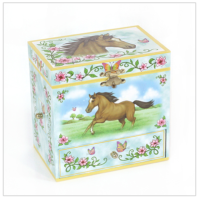 Musical jewelry box for girls with horses; lined interior, pop-up horse, multiple compartments, and three drawers.