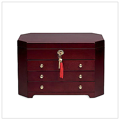 Ladies wooden jewelry chest with three pull-out drawers, hinged lid and multiple compartments, ring rolls and necklace hooks. The jewelry box has a fully lined, soft interior.