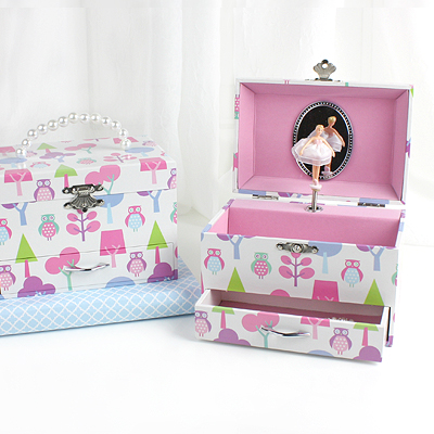 Adorable musical jewelry box for children with an owl design. Pop-up ballerina, pink lined interior, drawer, and faux pearl carry handle.