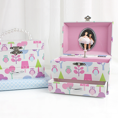 Musical jewelry box for girls with pop-up ballerina, pink lined interior, pull-out drawer and an owl motif.