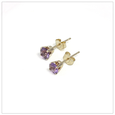 14kt gold February birthstone earrings, classic stud earrings with a push on back.