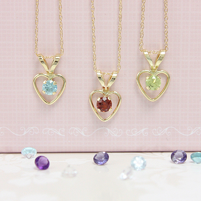 14kt gold heart necklace with July birthstone. Chain included. Toddler & children's jewelry.