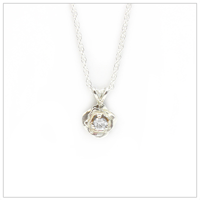 April birthstone necklace in rose shaped sterling silver setting, genuine white topaz birthstone.