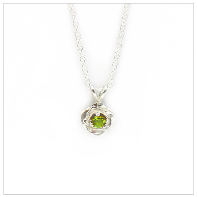 August birthstone necklace in rose shaped sterling silver setting, genuine peridot birthstone.