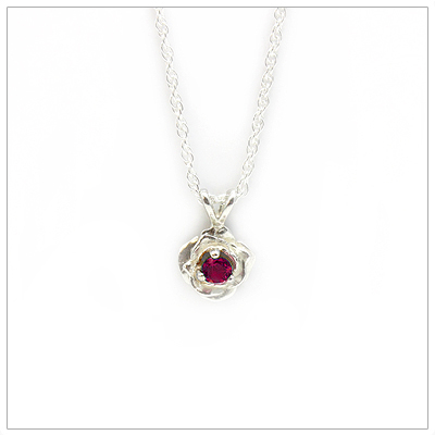 January birthstone necklace in rose shaped sterling silver setting, genuine garnet birthstone.