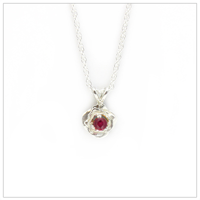 July birthstone necklace in rose shaped sterling silver setting, genuine ruby birthstone.