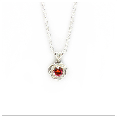 June birthstone necklace in rose shaped sterling silver setting, genuine rhodolite garnet birthstone.