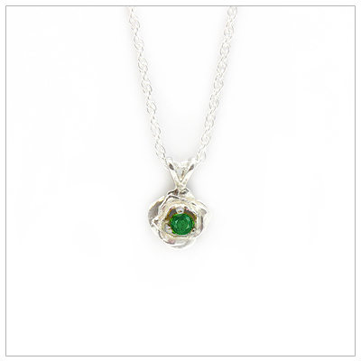 May birthstone necklace in rose shaped sterling silver setting, genuine emerald birthstone.