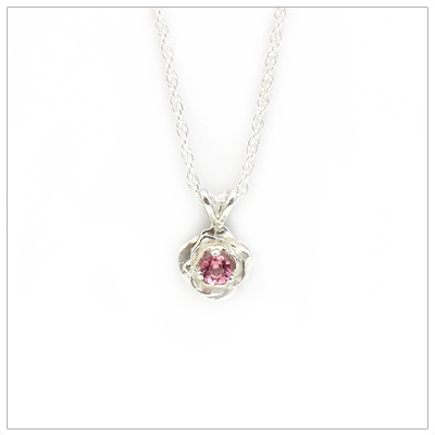 October birthstone necklace in rose shaped sterling silver setting, genuine pink tourmaline birthstone.