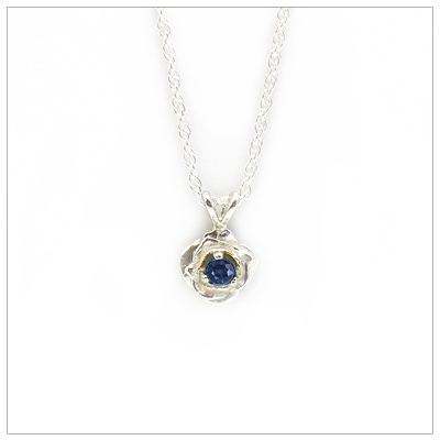September birthstone necklace in rose shaped sterling silver setting, genuine sapphire birthstone.