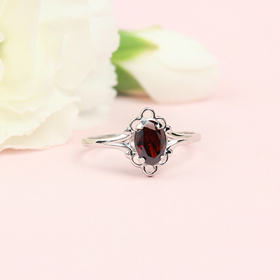 January birthstone ring for girls in sterling silver with a synthetic oval birthstone.
