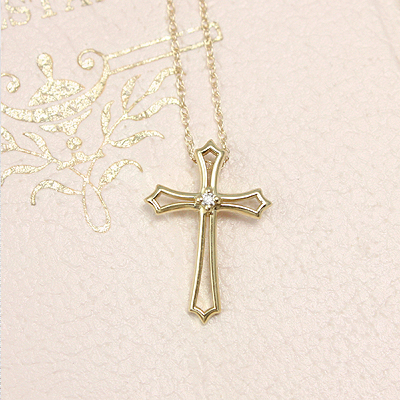 Fine 14kt gold diamond Cross necklace with a hidden bail. The Cross has an open design and is set with a 1.5mm diamond.