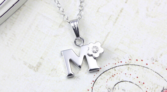 Personalized initial necklace for children with genuine diamond.