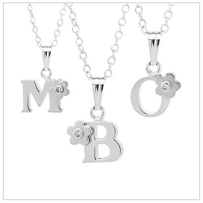 Sterling silver initial necklace for children set with a genuine diamond perched on a flower.