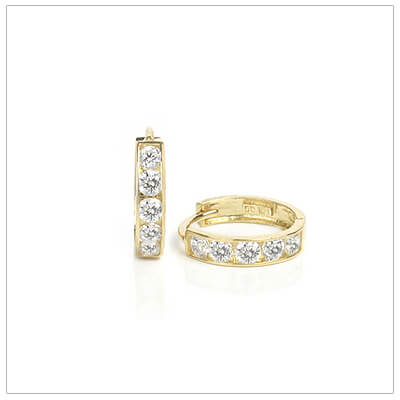 14kt gold huggie earrings for kids each set with 6 small cubic zirconia. The huggie earrings have a click closure.