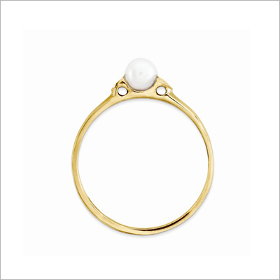Side view of children's gold and pearl ring.