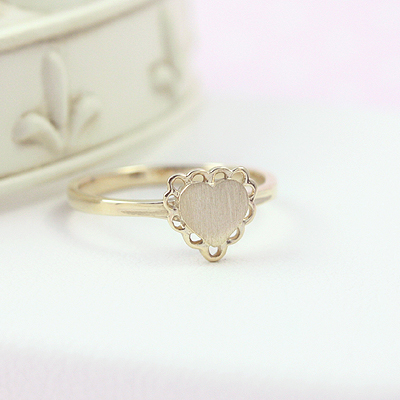 Heart shaped signet ring for girls in 10kt yellow gold. The quality signet ring has loop detailing on the front and engraving is included.