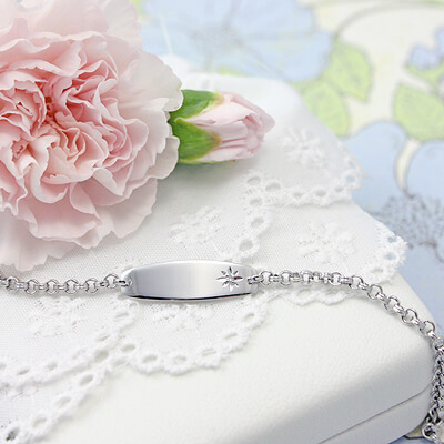 Girls diamond id bracelet in sterling silver with front engraving included.
