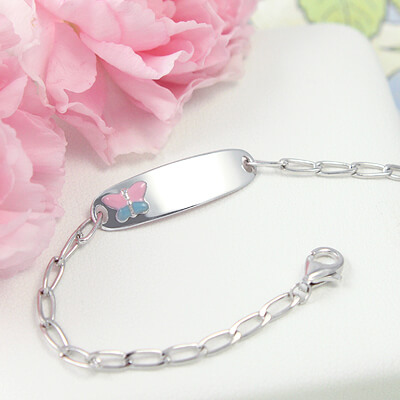 Kids sterling silver id bracelet with a pink butterfly on the front plate. Front engraving included.