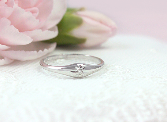 Girls sterling silver dome ring set with a genuine diamond.