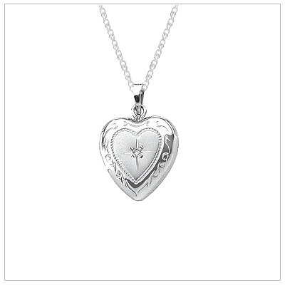 Sterling silver diamond heart locket for girls with embossed design. The heart locket holds two photos and chain is included.