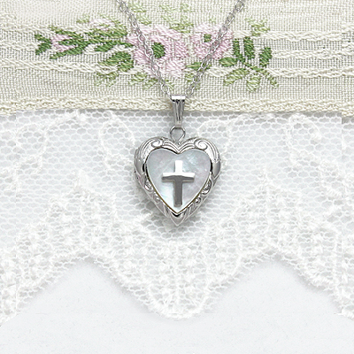 Sterling silver heart locket with inlaid mother of pearl and sterling silver Cross; holds small photo.