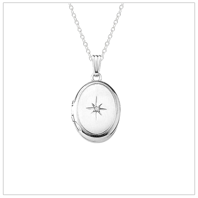 Sterling silver locket necklace for girls with a genuine diamond. The locket opens to hold 2 small photos.