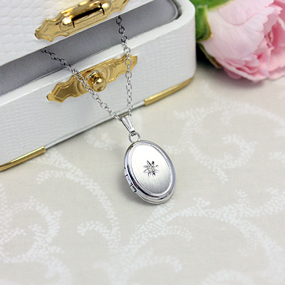 "Sterling diamond locket necklace with matte finish front. Custom engrave back. 15"" chain included."