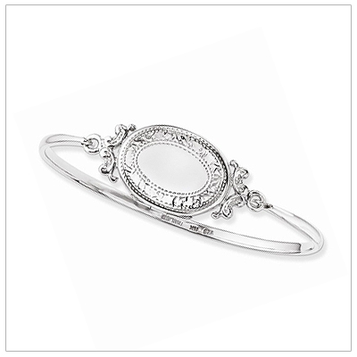 Sterling silver locket crafted into a bangle bracelet. The locket opens to holds photos.