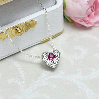 Beautifully detailed mothers necklace in a heart shape with raised filigree work and a genuine birthstone.