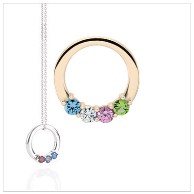 10kt gold circle mothers necklace shown with four genuine faceted birthstones.