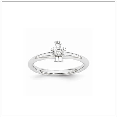 Sterling silver mother ring with a tiny boy on top set with a genuine white topaz for April.