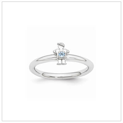 Sterling silver mother ring with a tiny boy on top set with a genuine blue topaz for December.