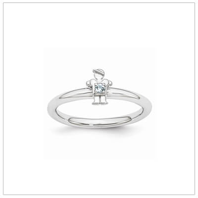Sterling silver mother ring with a tiny boy on top set with a genuine aquamarine for March.