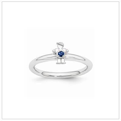 Sterling silver mother ring with a tiny boy on top set with a created sapphire for September.