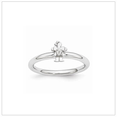 Sterling silver mother ring with a tiny girl on top set with a genuine white topaz for April.