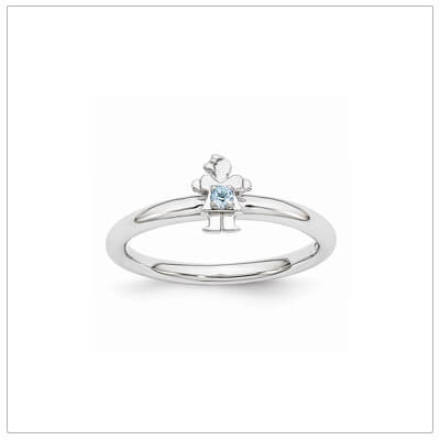 Sterling silver mother ring with a tiny girl on top set with a genuine blue topaz for December.
