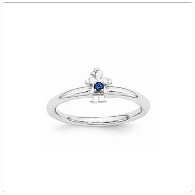 Sterling silver mother ring with a tiny girl on top set with a created sapphire for September.