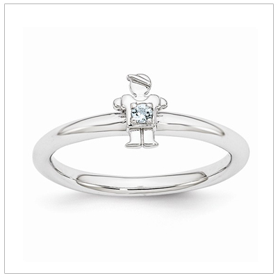 Stackable mothers March birthstone ring with a tiny boy on top set with a birthstone.