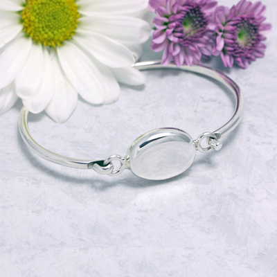 Personalized silver bangle bracelet engraved with a name or monogram. Beautiful silver bangles in a size 7 inches.