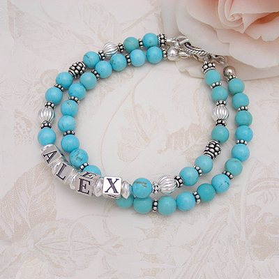 Turquoise name bracelets complimented with sterling silver. Our beaded bracelets include a second strand of turquoise, too.
