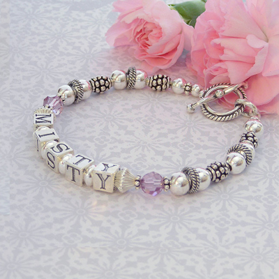 All silver mothers bracelets with free-floating rings and crystal birthstones. Customize your options on our mom bracelets.
