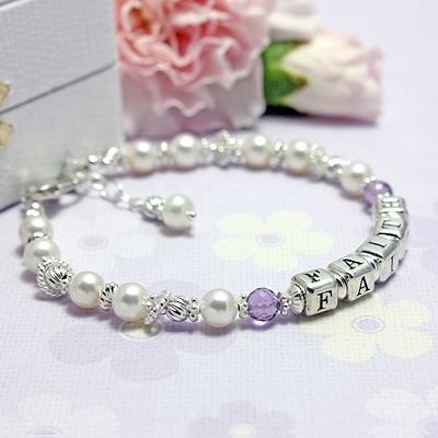 Beautiful personalized name bracelets with cultured pearls and genuine birthstones. The sterling twist beads have free-floating rings on our personalized bracelet.