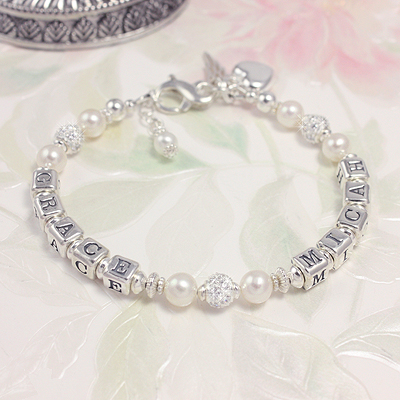 Personalized bracelets with two names, fine cultured pearls and sterling silver cz beads.